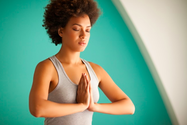 Meditation young woman of color.png