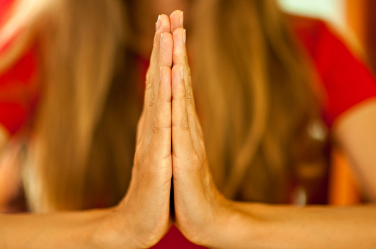 Prayer pose (red background).png