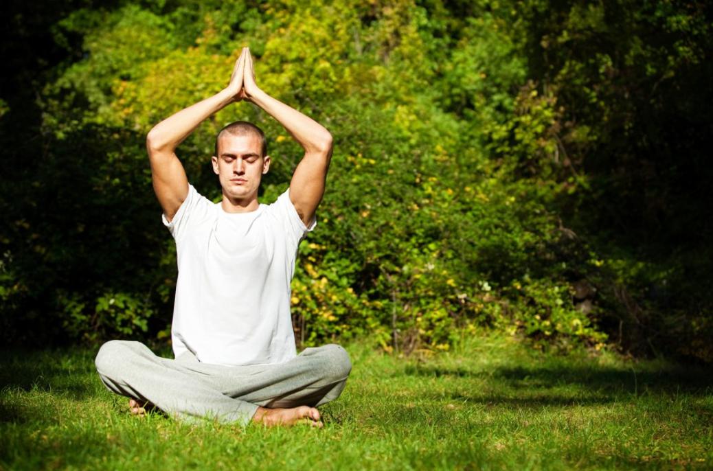 Man meditating green.png