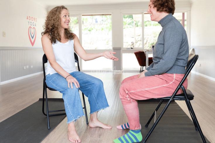 Yoga mentor and yoga teacher talking