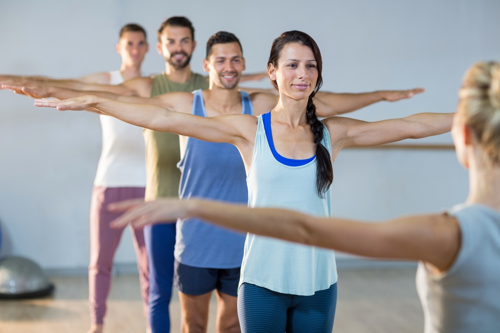Instructor taking yoga class in fitness studio-1
